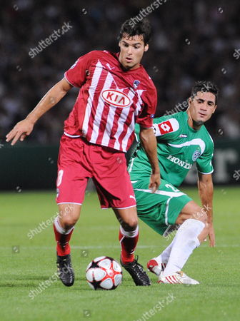 Bordeaux Player Yoann Gourcuff (l) Hits For the Ball Against Maccabi Haifa Player Dekel Keinan (l) During the Match For the Champion League in Bordeaux France 30 September 2009 France Bordeaux