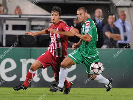 Bordeaux Player Yoann Gourcuff (l) Hits For the Ball Against Maccabi Haifa Player Dekel Keinan (r) During the Match For the Champion League in Bordeaux France 30 September 2009 France Bordeaux