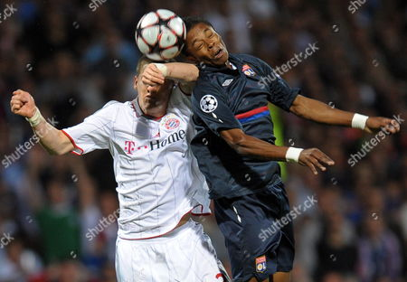 Jean Ii Makoun of Lyon Fights For the Ball with Bastian Schweinsteiger (l) of Fc Bayern Munich During the Uefa Champions League Semi Final 2nd Leg Match Between Olympique Lyon and Bayern Munich at the Gerland Stadium in Lyon France 27 April 2010 France Lyon