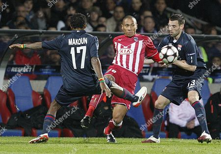 Jussie (c) of Girondins Bordeaux is Challenged by Jean Ii Makoun (l) and Anthony Reveillere (r) of Olympique Lyon During Their Champions League Quarter-final First Leg Soccer Match in Lyon France 30 March 2010 Lyon Won 3-1 France Lyon