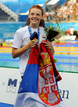 Stock Picture of Nadja Higl of Serbia Celebrates with Serbian Flag After Women's 200m Breaststroke Final at the 13th Fina World Championship in Foro Italico Swimming Complex in Rome Italy on 31 July 2009 Higl Won the Gold Medal Annamay Pierse of Canada Silver and Mirna Jukic of Austria Bronze Italy Rome
