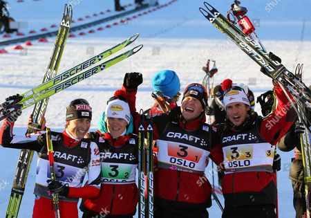 Austrian Team Skiers Mario Stecher (l) David Kreiner (2nd L) Bernhard Gruber (2nd R) and Felix Gottwald (r) Celebrate Their Victory After Nordic Combined Men's Lh Team Gundersen 4x5 Km Competition at the Nordic Skiing World Championships at the Holmenkollen Near Oslo Norway 04 March 2011 Norway Oslo