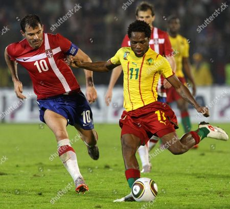 Dejan Stankovic (l) of Serbia Vies with Jean Ii Makoun (r) of Cameroon During Their Friendly Soccer Macht in Belgrade Serbia 05 June 2010 Serbia and Montenegro Belgrade