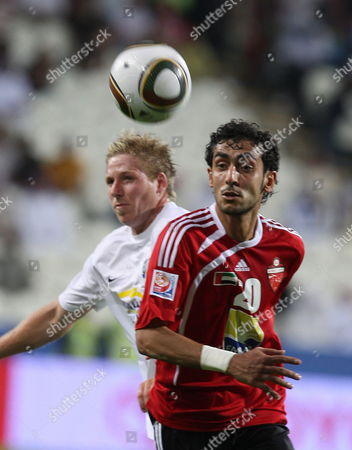 Al Ahli Fc Player Yousif Jaber (r) Struggles For the Ball with Auckland City Fc Player Jason Hayne (l) During Their Fifa Club World Cup Playoff Soccer Match at Mohammed Bin Zayed Stadium in Abu Dhabi United Arab Emirates 09 December 2009 Auckland Won 2-0 United Arab Emirates Abu Dhabi