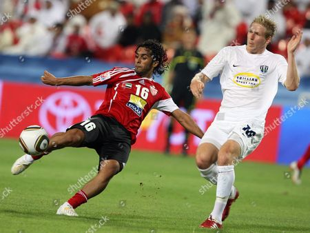 Al Ahli Fc Player Hassan Ali (l) Vies For the Ball with Auckland City Fc Player Jason Hayne (r) During Their Fifa Club World Cup Playoff Soccer Match at Mohammed Bin Zayed Stadium in Abu Dhabi United Arab Emirates 09 December 2009 United Arab Emirates Abu Dhabi