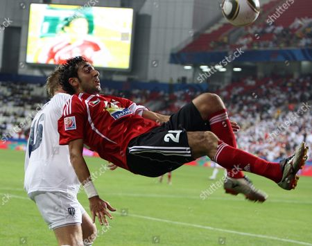 Al Ahli Fc Player Yousif Jaber (r) Performs an Overhead Kick in Front of Auckland City Fc Player Jason Hayne (l) During Their Fifa Club World Cup Playoff Soccer Match at Mohammed Bin Zayed Stadium in Abu Dhabi United Arab Emirates 09 December 2009 Auckland Won 2-0 United Arab Emirates Abu Dhabi
