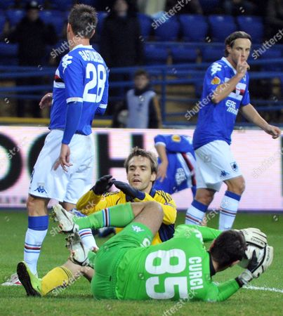 The Goalkeeper of Sampdoria Gianluca Curci Catches a Ball in Front of Marko Devic (yellow Jersey) of Metalist During Their Uefa Europa League Group i Soccer Match of Ukrainian Fc Metalist Kharkiv Vs Uc Sampdoria of Italy in Kharkiv Ukraine 21 October 2010 Ukraine Kharkiv