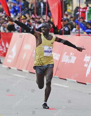 Sammy Wanjiru of Kenya Waves to the Crowd As He Approaches the Finish Line of the 2009 Bank of America Chicago Marathon in Chicago Illinois Usa 11 October 2009 Wanjiru Finished First Place with a Time of 2:05:41 Registration Was Closed Weeks Ago For the Event When the 45 000 Participant Limit Was Reached