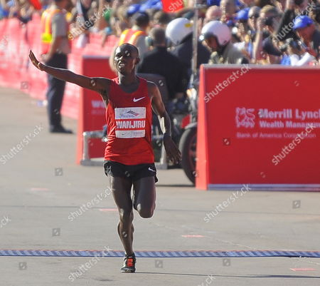 Sammy Wanjiru of Kenya Waves As He Makes His Way to the Finish Line to Win the Chicago Marathon in Chicago Illinois Usa 10 October 2010 45 000 People Registered For This Year's Event One of the Premier Marathons in the World United States Chicago