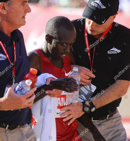 Sammy Wanjiru of Kenya (c) is Given Assistance After Winning the Chicago Marathon with a Time of 2:06:24 in Chicago Illinois Usa 10 October 2010 45 000 People Registered For This Year's Event One of the Premier Marathons in the World United States Chicago