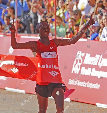 Sammy Wanjiru of Kenya Crosses the Finish Line to Win the Chicago Marathon in Chicago Illinois Usa 10 October 2010 45 000 People Registered For This Year's Event One of the Premier Marathons in the World United States Chicago