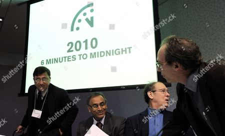 From Left Scientists Pervez Hoodbhoy Jayantha Dhanapala Stephen Schneider and Lawrence Krauss Talk Following the Announcement by the Bulletin of Atomic Scientists of an Adjustment of the 'Doomsday Clock' From 5 to 6 Minutes Before Midnight at the New York Academy of Sciences in New York New York Usa 14 January 2010 the 'Doomsday Clock' was Created in 1947 by the Bulletin of Atomic Scientists As Way to Communicate the Imagery of the Apocalypse Represented by Midnight and the Countdown of a Nuclear Explosion United States New York