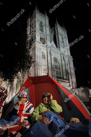 Terry Hutt(l) and Jennifer Hawkins (r) Sit Under Their Tent in Front of Westminster Abbey where the Royal Wedding Will Take Place Late Night on 26 April 2011 Prince William and His Bride to Be Kate Middleton Will Get Married at Westminster Abbey on 29 April United Kingdom London