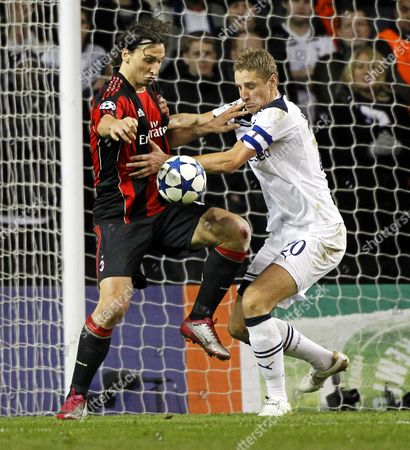 Michael Dawson (r) of Tottenham Hotspur Vies For the Ball with Ac Milan's Zlatan Ibrahimovic (l) During Their Uefa Champions League Round of 16 Second Leg Soccer Match at White Harte Lane Stadium in London Britain 09 March 2011 the Spurs Won 1-0 on Aggregate and Advanced to the Quarter Final United Kingdom London