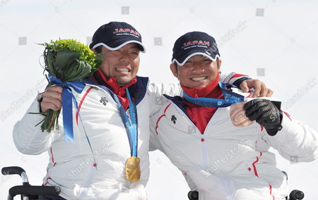 Gold Medalist Akira Kano and Bronze Medalist Taiki Morii of Japan Celebrate Their Wins in the Men?s Super G Sitting Competition at the Vancouver 2010 Paralympic Games 19 March 2010 Canada Whistler