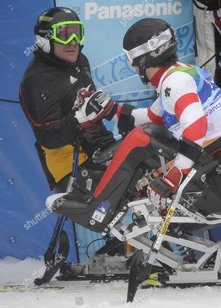 Martin Braxenthaler of Germany and Switzerland's Christoph Kunz Congratulate One Another Following the Men?s Giant Slalom Sitting Competition at the Vancouver 2010 Paralympic Games 16 March 2010 Braxenthaler Beat out For the Win Canada Whistler