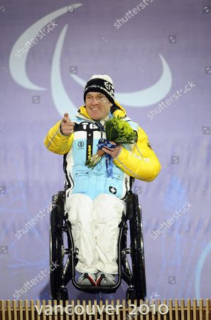 Martin Braxenthaler of Germany Celebrates His Gold Medal Win During a Victory Ceremony For the Men's Giant Slalom Sitting Competition at the Vancouver 2010 Paralympic Games in Whistler Canada 16 March 2010 Canada Whistler