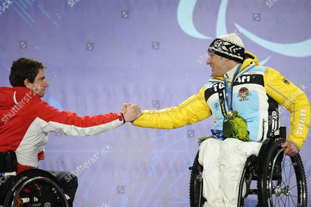 Silver Medalist Christoph Kunz (l) of Switzerland and Gold Medalist Martin Braxenthaler of Germany Congratulate One Another During a Victory Ceremony For the Men's Giant Slalom Sitting Competition at the Vancouver 2010 Paralympic Games in Whistler Canada 16 March 2010 Canada Whistler