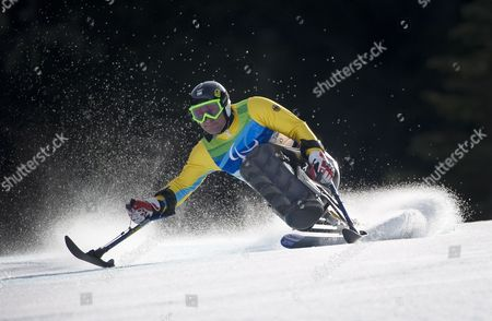 Stock Image of Germany's Martin Braxenthaler in Action During the Super G Portion of the Men's Super Combined Sitting Competition at the Vancouver 2010 Paralympic Games 20 March 2010 Canada Whistler