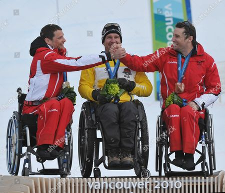 Silver Medalist Jurgen Egle (l) of Austria Congratulates Teammate and Bronze Medalist Philipp Bonadimann (r) Between Gold Medalist Martin Braxenthaler (c) of Germany During the Medal Ceremony For the Men's Super Combined Sitting Competition at the Vancouver 2010 Paralympic Games in Whistler Canada 21 March 2010 Canada Whistler