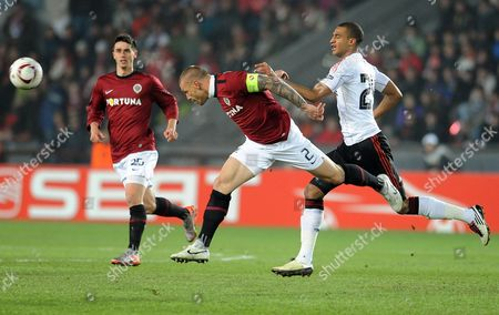 David Ngog (r) of Liverpol Fc Vies For the Ball with Tomas Repka (c) and Kamil Vacek (l) of Sparta Prague During Their Uefa Europa League Round of 32 Soccer Match in Prague Czech Republic 17 February 2011 Czech Republic Prague