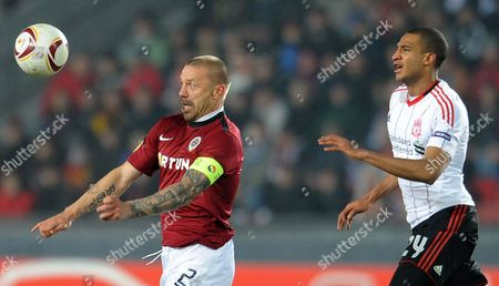 David Ngog (r) of Liverpol Fc Vies For the Ball with Tomas Repka (l) of Sparta Prague During Their Uefa Europa League Round of 32 Soccer Match in Prague Czech Republic 17 February 2011 Czech Republic Prague