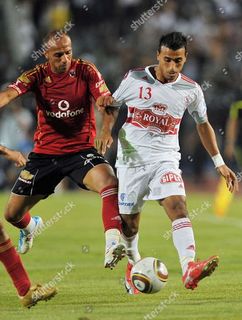 Egypt's Al-zamalek Player Mohamed Abdel-shafy (r) Fights For the Ball with Al-ahly Player Mo'taz Bellah Eno (l) During Their Egyptian Premier League Soccer Match in Cairo Egypt 29 June 2011 the Match Had Been Postponed Earlier on 29 June Following Clashes During the Night Between Protesters and Security Forces But the Decison was Reversed Later the Same Day Egypt Cairo