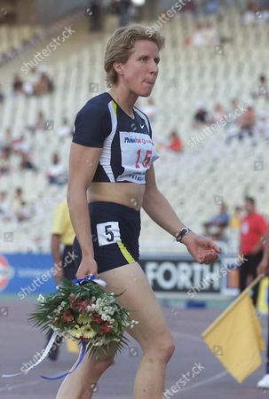 Athens Greece: Britains Katharine Merry Walks with Flowers After Running the Best World Result of 2001 at the Womens 400m with a Time of 49 59sec During the International Outdoor Athletics Meeting Named Tsiglitiria in Athens Monday 11 June 2001