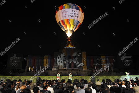 As Drawings Are Projected on the Seitoku Memorial Exhibition Hall a Balloon Lifts Off During an Event Produced by Japanese Designer Kansai Yamamoto and Held to Promote Tokyo's Candidacy For the 2016 Olympics in Tokyo Japan 11 September 2009 Tokyo Chicago Madrid and Rio De Janeiro Are the Final Candidates and the Decision on who Will Host the Games Will Be Made in 02 October 2009 Japan Tokyo