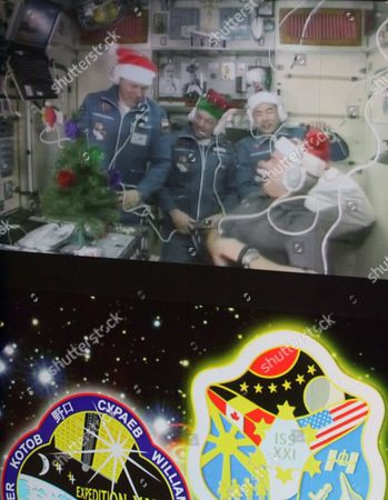 A Screen in the Russian Mission Control Centre Shows Space Crew Member of the Mission-20 to the International Space Station Japanese Astronaut Soichi Noguchi (r-top) Nasa Astronaut Timothy Creamer (c) Russian Cosmonaut Oleg Kotov (l) Arrived in the International Space Station Aboard Soyuz Tma-17 Space Craft in the City of Korolev Outside Moscow Russia 23 December 2009 Russian Cosmonaut Maxim Surayev (out of Picture) and Nasa Astronaut Jeffrey Williams (r) Join Other Three Astronauts Working Aboard the International Space Station Enlarging Space Team Till Five People Working Together Long Term Russian Federation Korolev
