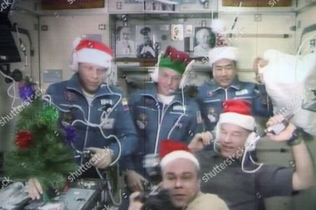 Screen in the Russian Mission Control Centre Shows Space Crew Members of the Mission-20 to the International Space Station Japanese Astronaut Soichi Noguchi (r-top) Nasa Astronaut Timothy Creamer (c) Russian Cosmonaut Oleg Kotov (l) Arrived in the International Space Station Aboard Soyuz Tma-17 Space Craft in the City of Korolev Outside Moscow Russia 23 December 2009 Russian Cosmonaut Maxim Surayev (c-bottom) and Nasa Astronaut Jeffrey Williams (r) Join Other Three Astronauts Working Aboard the International Space Station Enlarging Space Team Till Five People Working Together Long Term Russian Federation Korolev
