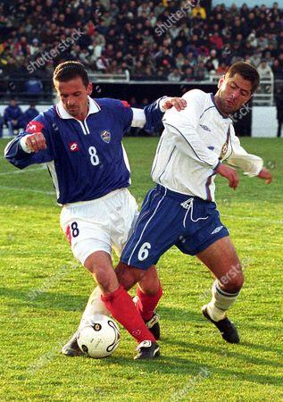 Podgorica Yugoslavia : Predrag Mijatovic (l) of Yugoslavia Tackle Adahim Niftaliyev (r) of Azerbaijan During Qualification Match For Euro 2004 in Podgorica Montenegro 12 February 2003 Match Ended by 2:2 Draw