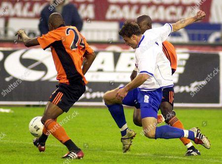 Dragan Blatnjak (c) of Hajduk Split is Challenged by Kim Jaggy (l) and Femi Opabunmi of Grasshopper Zurich During the Uefa Cup 1st Round 2nd Leg Match in Split Wednesday 15 October 2003 Croatia Split