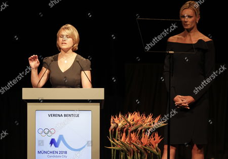 Verena Bentele Blind German Paralympic Biathlete and Cross Country Skier (l) Speaks As German Alpine Ski Racer Maria Hoefl-riesch Looks on During the Presentation of the Munich Bid to the International Olympic Committee's (ioc) 123rd Session in Durban South Africa 06 July 2011 the International Olympic Committee Session Votes to Choose Hosts of 2018 Winter Olympics Following Presentations by Bid Candidates Munich in Germany Annecy in France and Pyeongchang in South Korea South Africa Durban