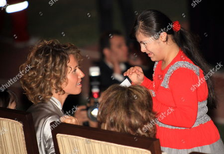 Syrian First Lady Asma Al-assad (l) Speaks with Young Athlete Prior to the Opening of the Special Olympics 7th Mena Regional Games For Handicapped at the Tishrin Stadium in Damascus Syria on 25 September 2010 the Event is Held Under the Auspices of Asma Al-assad the Honorary Chairwoman of the Special Olympics in Syria Some 1 600 Athletes From 23 Middle East and North African (mena) Countries Will Compete in 15 Different Disciplines Syrian Arab Republic Damascus