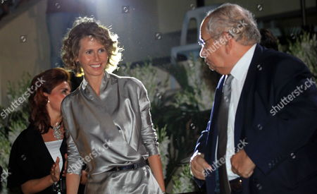Syrian First Lady Asma Al-assad (2l) is Accompanied by Unidentified Officials As She Arrives to Attends the Opening of the Special Olympics 7th Mena Regional Games For Handicapped at the Tishrin Stadium in Damascus Syria on 25 September 2010 the Event is Held Under the Auspices of Asma Al-assad the Honorary Chairwoman of the Special Olympics in Syria Some 1 600 Athletes From 23 Middle East and North African (mena) Countries Will Compete in 15 Different Disciplines Syrian Arab Republic Damascus
