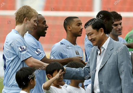 Manchester City's Club Owner and Thai Deposed Premier Thaksin Shinawatra (r) Greets His Soccer Players Benjamin Mee (l) Darius Vassell (2nd L) and Shaleum Logan (3rd L) Prior Manchester City Vs Thailand Premier All Star Team Friendly Soccer Match at Rajamangala Stadium in Bangkok Thailand 17 May 2008