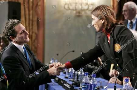 Nawal El Moutawkel the Chairwoman of the International Olympic Commitee Evaluation Commission (r) Shakes Hands with Dan Doctoroff the Founder of Nyc 2012 at the Conclusion of the Press Conference Concerning the 2012 New York City Olympic Bid at the Plaza Hotel in New York City Thursday 24 February 2005 the 13 Person Commission Spent Four Days in New York Visiting Sites and Evaluating New York Against Competing Cities London Paris Madrid and Moscow For the 2012 Summer Olympics the Final Decision Wil Be Announced in Singapore On July 6th 2005