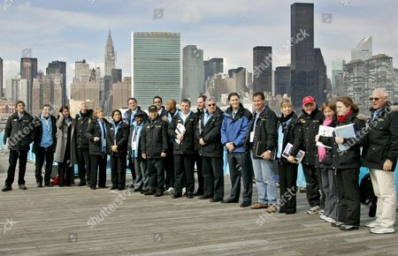 Nawal El Moutawkel the Chairwoman of the International Olympic Committee Evaluation Commission (6th From Left) and Dan Doctoroff Founder of Nyc 2012 (7th From Left) Join the Entire Olympic Committee Evaluation Commission and Past Olympians at the Long Island City Waterfront with the United Nations Building in the Backround For a Media Picture Tuesday 22 February 2005 the 13 Person Commission Will Spend Four Days in New York Visiting Sites and Evaluating New York Against Competing Cities London Paris Madrid and Moscow For the 2012 Summer Olympics the Decision Will Be Made in Singapore On the 6th of July 2005