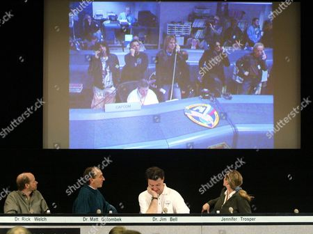 Member of the Mars Exploration Rover Mission Team From Left Rick Welch Matt Golombek Jim Bell and Jennifer Trosper at the Jet Propulsion Laboratory in Pasadena California Look at a Live Video Feed of the Group Arrowsmith at the Johnson Space Center in Houston As They Communicate with Astronauts Onboard the International Space Station On Wednesday 28 January 2004