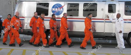 Stock Picture of Space Shuttle Discovery Crew On Mission Sts-119 Walk Smiling and Waving to Their Van After Leaving the Operations and Check out Building (o&c) at Kennedy Space Center Cape Canaveral Florida Usa 15 March 2009 Crew Members Are (r-l) Commander Lee Archambault Pilot Tony Antonelli Mission Specialists Joseph Acaba Steve Swanson Richard Arnold John Phillips and Japan Space Agency Koichi Wakata the Seven Man Crew Will Fly On Shuttle Discovery On a Fourteen Day Mission to the International Space Station (iss) Japanese Astronaut Koichi Wakata Will Remain at the Iss For the Next Four Months