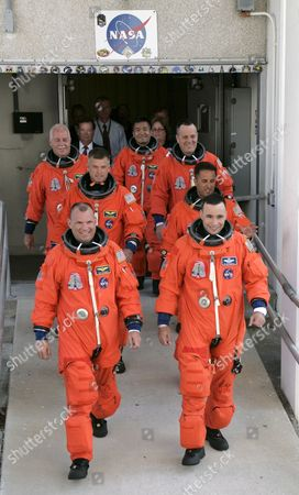 Stock Image of Space Shuttle Discovery Crew On Mission Sts-119 Leaving the Operations and Check out Building (o&c) at Kennedy Space Center Cape Canaveral Florida Usa 15 March 2009 Crew Members Are (r-l) Commander Lee Archambault Pilot Tony Antonelli Mission Specialists Joseph Acaba Steve Swanson Richard Arnold John Phillips and Japan Space Agency Koichi Wakata the Seven Man Crew Will Fly On Shuttle Discovery On a Fourteen Day Mission to the International Space Station (iss) Japanese Astronaut Koichi Wakata Will Remain at the Iss For the Next Four Months