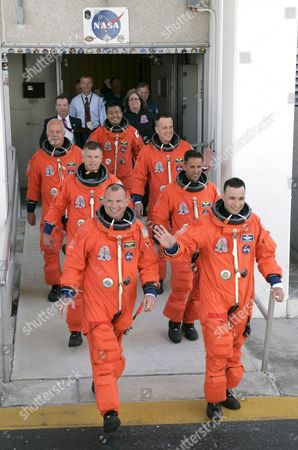 Space Shuttle Discovery Crew On Mission Sts-119 Pose For a Group Photo During the Walkout After Leaving the Operations and Check out Building (o&c) at Kennedy Space Center Cape Canaveral Florida Usa 15 March 2009 Crew Members Are (r-l) Commander Lee Archambault Pilot Tony Antonelli Mission Specialists Joseph Acaba Steve Swanson Richard Arnold John Phillips and Japan Space Agency Koichi Wakata the Seven Man Crew Will Fly On Shuttle Discovery On a Fourteen Day Mission to the International Space Station (iss) Japanese Astronaut Koichi Wakata Will Remain at the Iss For the Next Four Months