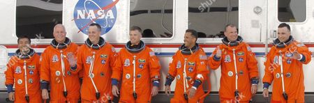 Space Shuttle Discovery Crew On Mission Sts-119 Walk Smiling and Waving in Front of Their Van After Leaving the Operations and Check out Building (o&c) at Kennedy Space Center Cape Canaveral Florida Usa 15 March 2009 Crew Members Are (r-l) Commander Lee Archambault Pilot Tony Antonelli Mission Specialists Joseph Acaba Steve Swanson Richard Arnold John Phillips and Japan Space Agency Koichi Wakata the Seven Man Crew Will Fly On Shuttle Discovery On a Fourteen Day Mission to the International Space Station (iss) Japanese Astronaut Koichi Wakata Will Remain at the Iss For the Next Four Months