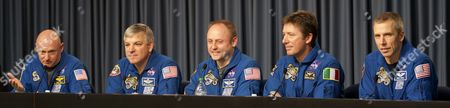 The Crew of Sts-134 (l-r) Commander Mark Kelly Pilot Greg Johnson and Mission Specialists Mike Fincke Roberto Vittori and Drew Feustel Take Questions From the Media During the Post-landing Crew Press Conference at Kennedy Space Center Cape Canaveral Florida Usa 01 June 2011 Endeavour Touched Down at 2:35:26 Am Eastern Time to Conclude It's Final Mission That Delivered the 2 Billion Us Dollar Alpha Magnetic Spectrometer and Other Supplies to the International Space Station United States Cape Canaveral
