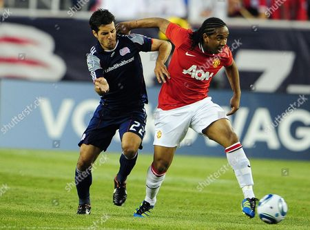 Stock Photo of Manchester United's Anderson of Brazil (r) Battles New England Revolution's Benny Feilhaber of Brazil (l) For the Ball During the First Half of Their Match at Gillette Stadium in Foxborough Massachusetts Usa 13 July 2011 the Match is the First in the 14-match Herbalife World Football Challenge Which Ends 06 August 2011 and Will Feature Matches All Over the Us and Canada United States Foxborough