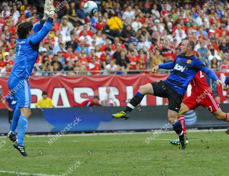 Manchester United Forward Wayne Rooney(r) Lifts the Ball Over the Head of Chicago Fire Goal Keeper Jon Conway (l) For a Go-ahead Score in the Second Half of the Herbalife World Football Challenge 2011 at Soldier Field in Chicago Illinois Usa 23 July 2011 Manchester United Defeated the Chicago Fire 2-1 United States Chicago