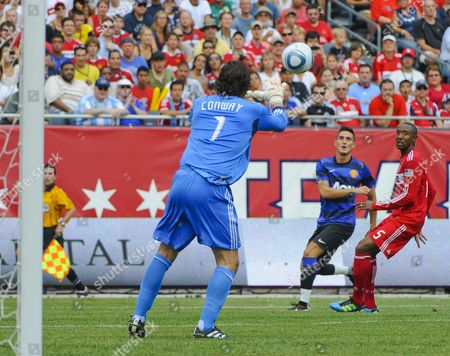 Chicago Fire Goal Keeper Jon Conway (l) Stops a Shot on Goal by Manchester United Forward Federico Macheda As Chicago Fire Defender Cory Gibbs (r) Watches in the Second Half of the Herbalife World Football Challenge 2011 at Soldier Field in Chicago Illinois Usa 23 July 2011 Manchester United Defeated the Chicago Fire 2-1 United States Chicago