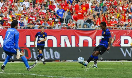 Manchester United Midfielder Nani (r) Kicks the Ball Past Chicago Fire Goal Keeper Jon Conway For a Goal in the Second Half of the Herbalife World Football Challenge 2011 at Soldier Field in Chicago Illinois Usa 23 July 2011 Manchester United Defeated the Chicago Fire 3-1 United States Chicago