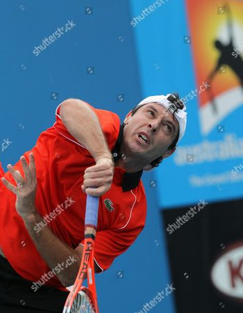 Sebastien Grosjean of France Serves Against Marsel Ilhan of Turkey During Their First Round Match at the Australian Open Tennis Tournament in Melbourne Australia 18 January 2010 Australia Melbourne